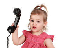 Little girl holding t�l�phone Royalty Free Stock Photos