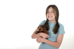 Little Girl Holding Teddy Bear 1. Little girl with big, cheshire cat grin, smiling and holding a teddy bear. Shot on white stock image