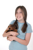 Little Girl Holding Teddy Bear 2. Little girl with grin, smiling and holding a teddy bear.  Shot on white Stock Photography