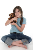 Little Girl Holding Teddy Bear 6. Little girl with big grin, smiling and sitting on floor holding a teddy bear.  Shot on white Stock Photography