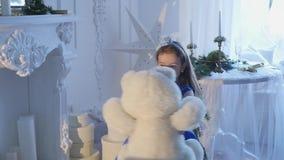 Little girl holding a teddy bear stock footage