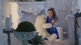 Little girl holding a teddy bear stock video footage