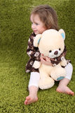 Little girl holding a teddy bear Royalty Free Stock Photo