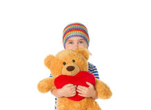 Little girl holding Teddy bear and heart. Stock Images