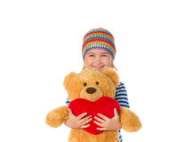 Little girl holding Teddy bear and heart. Royalty Free Stock Photography