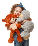 Little girl holding a teddy bear. Isolated on white background Royalty Free Stock Images