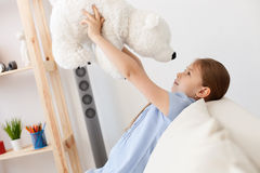 Little girl holding teddy bear Stock Photo