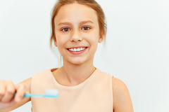 Little girl holding Teeh Brush.  Happy girl brushing her teeth Stock Images
