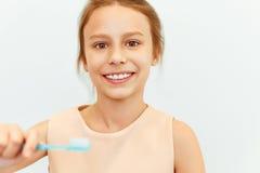 Little girl holding Teeh Brush.  Happy girl brushing her teeth Stock Images