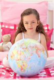 Little girl holding a terrestrial globe Royalty Free Stock Photo