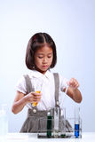 Little girl holding a test tube with liquid scientist chemistry and science Royalty Free Stock Photography