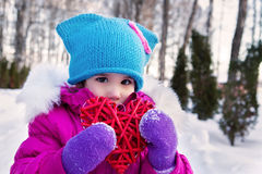 Little girl holding in their hands hearts themes Valentine`s day , the day of the winter on the street in the Park Royalty Free Stock Photo