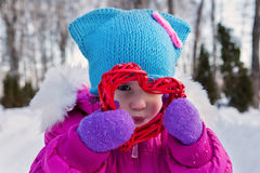 Little girl holding in their hands hearts themes Valentine`s day , the day of the winter on the street in the Park Royalty Free Stock Images