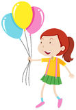 Little girl holding three balloons Stock Image