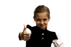 Little girl holding a thumb up. On a white background Stock Photo