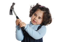 Little girl holding tools Royalty Free Stock Image