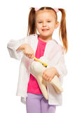 Little girl holding tooth model and yellow brush. Little girl playing dentist holding tooth model and brush showing proper tooth brushing technique, isolated in Royalty Free Stock Images