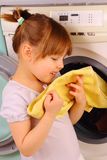 A little girl is holding a towel after washing Royalty Free Stock Photography