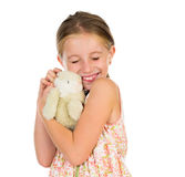 Little girl holding toy bunny with her eyes squinted Royalty Free Stock Photography