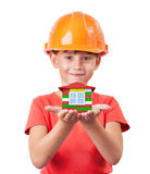 Little girl holding toy house. Little girl in a helmet holding toy house Stock Photography