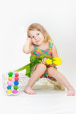 Little girl holding tulips with Easter eggs Stock Photos