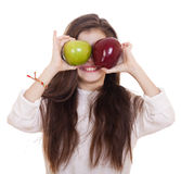 Little girl holding two apples Stock Photos