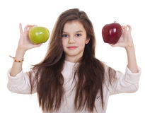Little girl holding two apples Royalty Free Stock Image