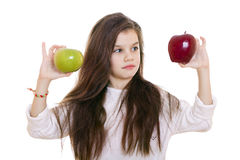 Little girl holding two apples Royalty Free Stock Photo
