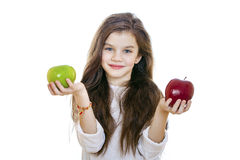 Little girl holding two apples Royalty Free Stock Photography