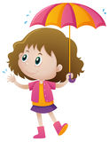 Little girl holding umbrella Stock Photo