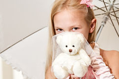Little girl holding umbrella and wedding teddy Royalty Free Stock Photography