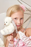 Little girl holding umbrella and wedding teddy Royalty Free Stock Image