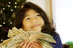 Little girl holding up cash Royalty Free Stock Photography