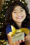 Little girl holding up cash Royalty Free Stock Image