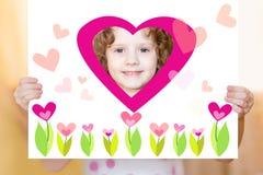 Little girl holding a valentine postcard. Stock Photos