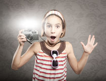 Little girl holding  a vintage camera Stock Image