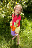 Little girl holding a  watering can Stock Photography
