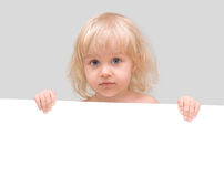 Little girl holding a white banner Stock Photography