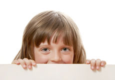 Little girl holding  white board Royalty Free Stock Image