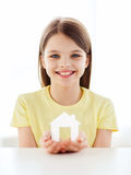 Little girl holding white paper house Stock Photography