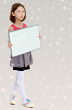 Little girl holding white poster. Royalty Free Stock Photos