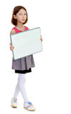 Little girl holding white poster. Royalty Free Stock Photo