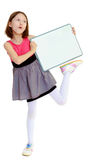 Little girl holding white poster. Stock Photo