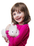 Little girl holding a little white rabbit Royalty Free Stock Image