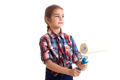 Little girl holding white roll Royalty Free Stock Photos