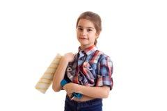 Little girl holding white roll Stock Photography