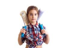 Little girl holding white rolls Royalty Free Stock Photos