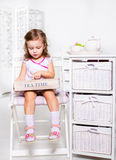 Little girl holding wooden box Royalty Free Stock Photos