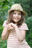 Little girl holding yellow chicken Stock Photography