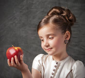 Little girl holds apple. Little girl holds red apple Stock Photo